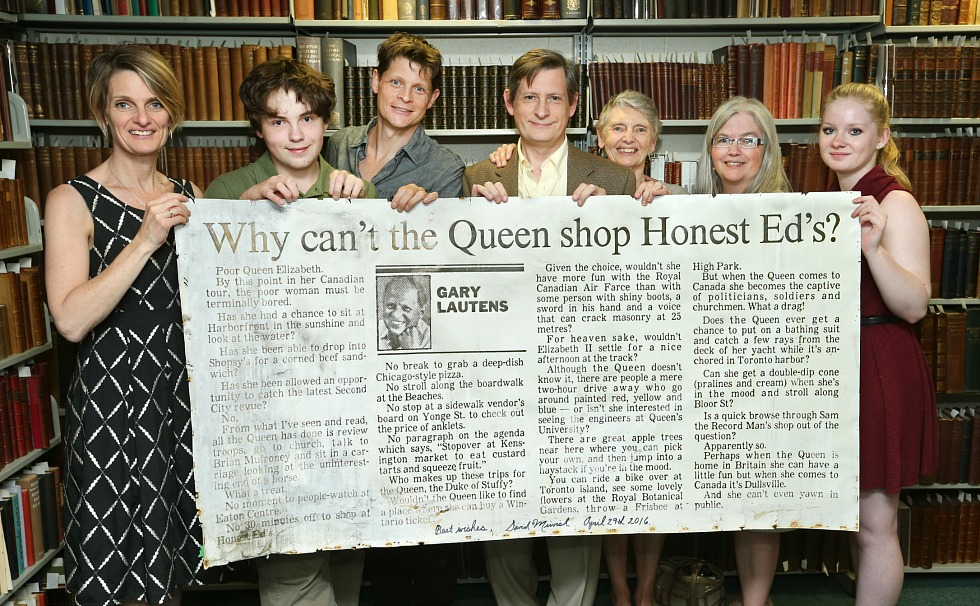 The family of award-winner writer and McMaster alumnus Gary Lautens with a column written by Lautens that was displayed for more than 30 years outside Honest Ed's. Left to right: Jane (daughter); James (grandson, son of Stephen and Rhea); Richard (son); Stephen (son); Jackie (wife); Rhea (Stephen's wife); Chelsea (granddaughter, daughter of Jackie; currently a Mac student).