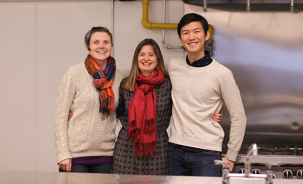 Tina Moffat (pictured centre), an associate professor in McMaster's Anthropology Department and this year's Scholar-in-Community, with Clare Wagner, the director of the Hamilton Community Food Centre and third-year Health Sciences student, Jun Park. Moffat is working in partnership with staff and community members at Neighbour 2 Neighbour's Hamilton Community Food Centre to develop a framework to evaluate the Food Centre's programs, and identify new ways to support those who either can't afford – or don't have access to – healthy food.