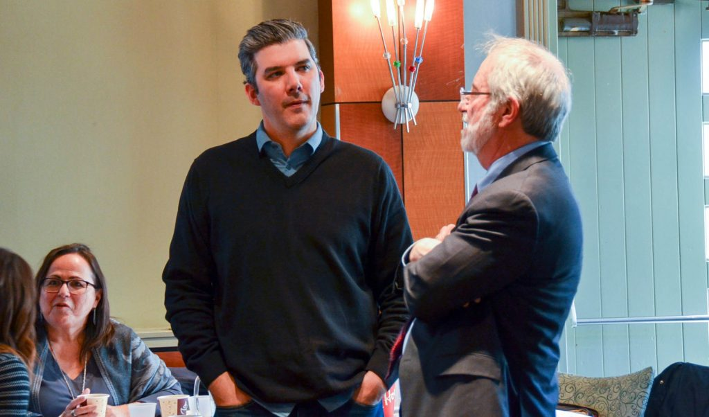 Hayden King, director of the Ryerson Centre for Indigenous Governance, left, speaks to McMaster University President Patrick Deane at the MIRI Symposium in March 2018