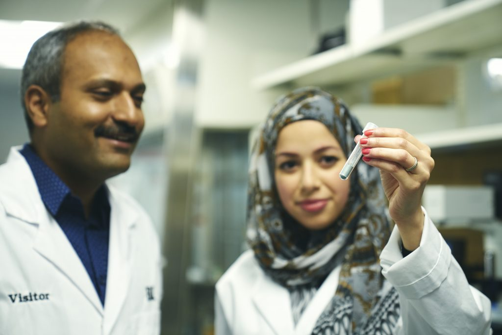 Ravi Selvaganapathy and Rana Attalla in a McMaster lab looking at a test tube
