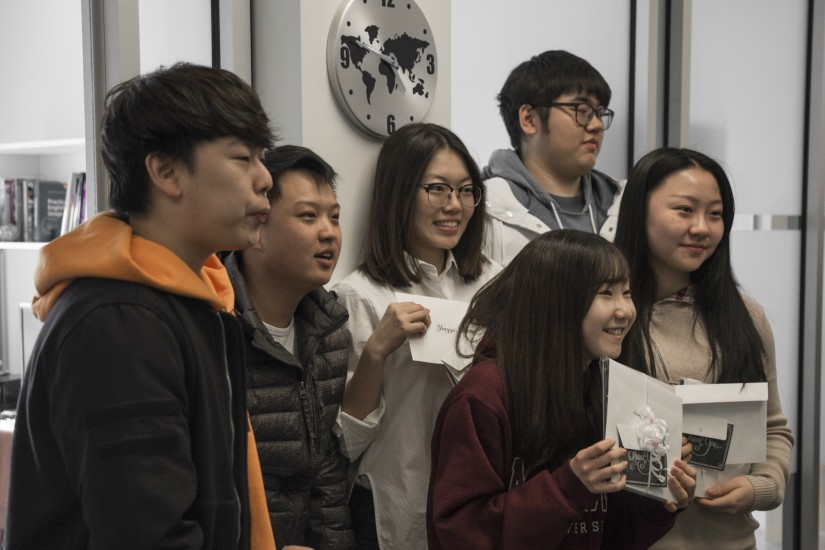 A group of McMaster ESL students hold thank you cards