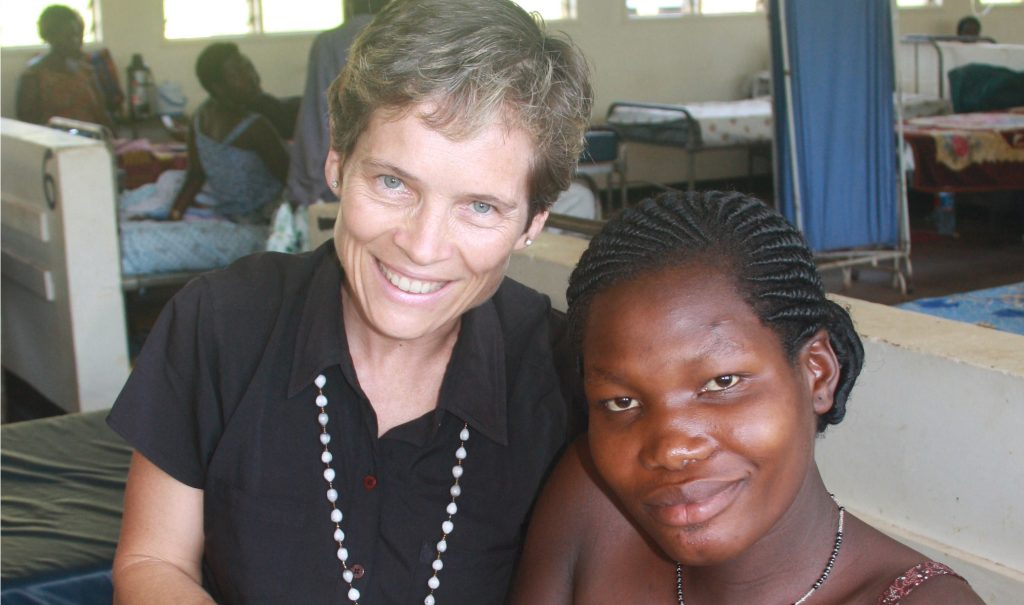 Dr. Jean Chamberlain Froese, seen here with a mother and baby in Kawolo General Hospital in Uganda