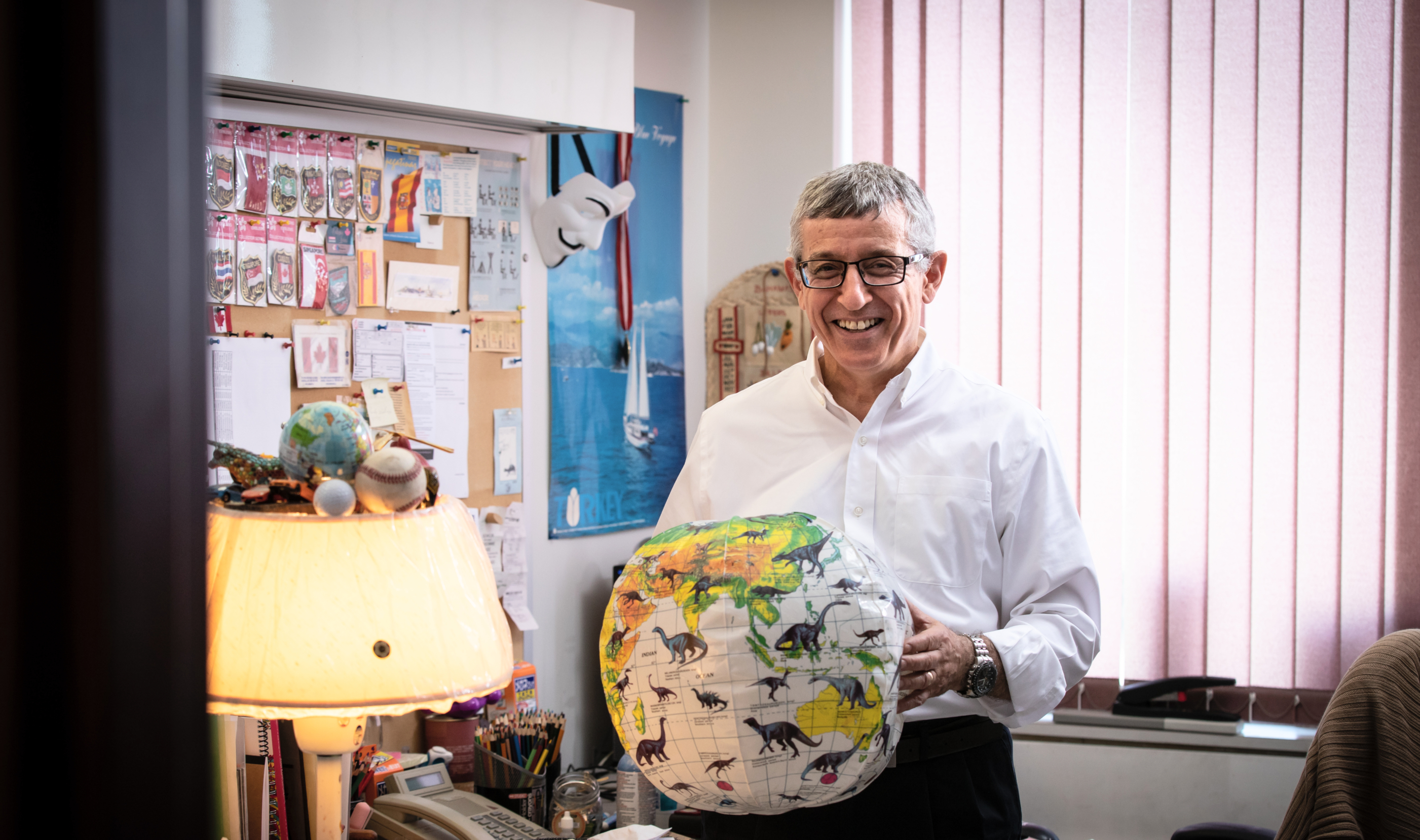 Distinguished Business professor of operations management Mahmut Parlar holds a beach ball in his DeGroote School fo Business office. JD Howell photo