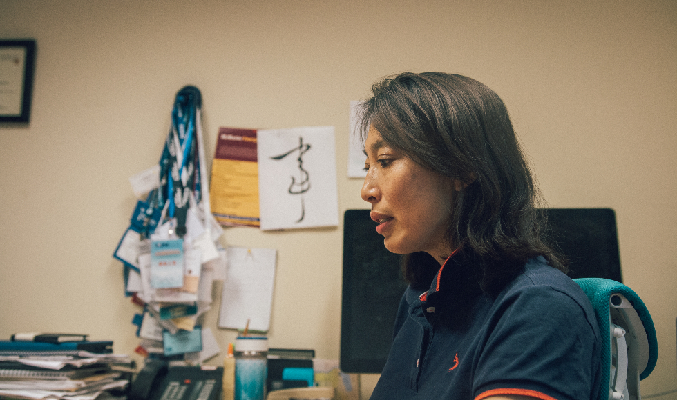 McMaster engineering professor Rong Zheng sits at her desk