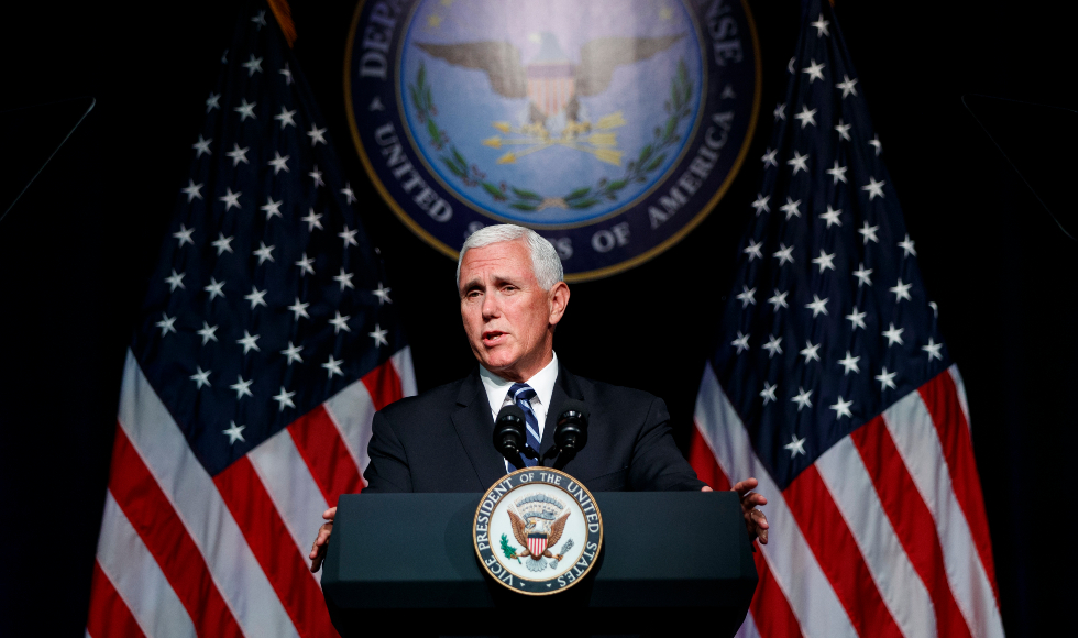 US vice president Mike Pence stands at a podium in front of an American flag
