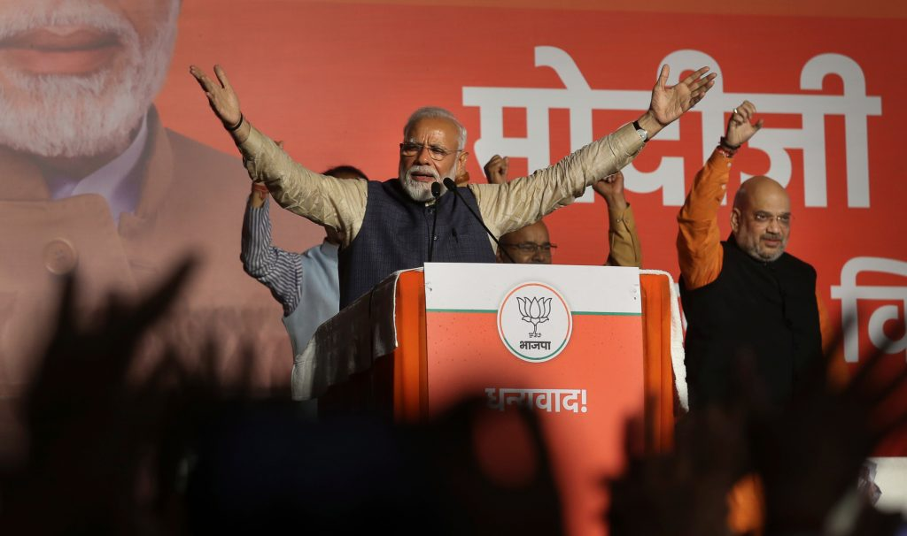Indian PM Narendra Modi giving a victory speech at a podium on election night in New Delhi