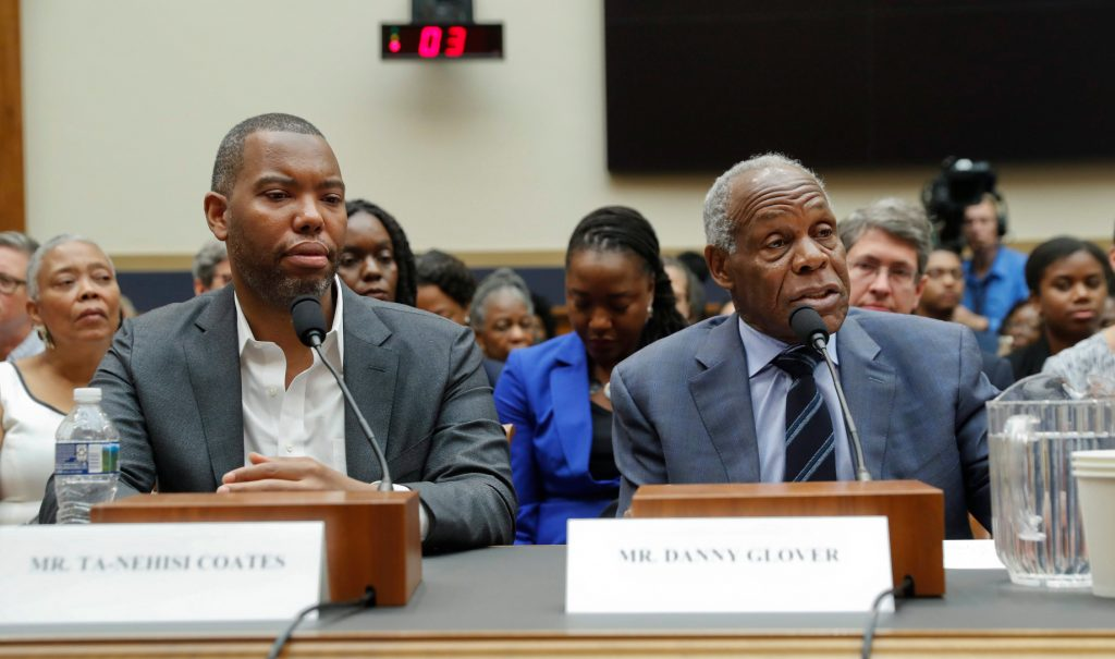 Author Ta-Nehisi Coates and actor Danny Glover sit side by side at a at a table to testify during a hearing before the House Judiciary Subcommittee on Capitol Hill on June 19, 2019.