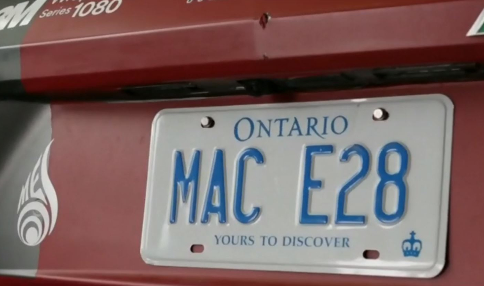 Picture of a license plate that says MAC E28