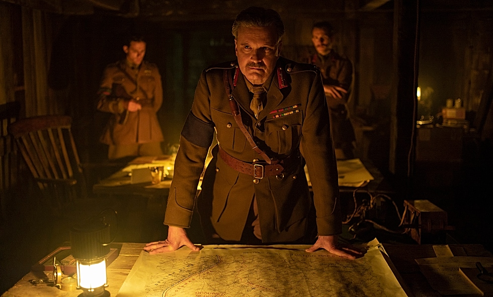 In this image from the film, 1917, Colin Firth as General Erinmore stands over a map from McMaster's extensive World War One trench map collection. The map was modified slightly for use in the film. Image courtesy of Universal Pictures.