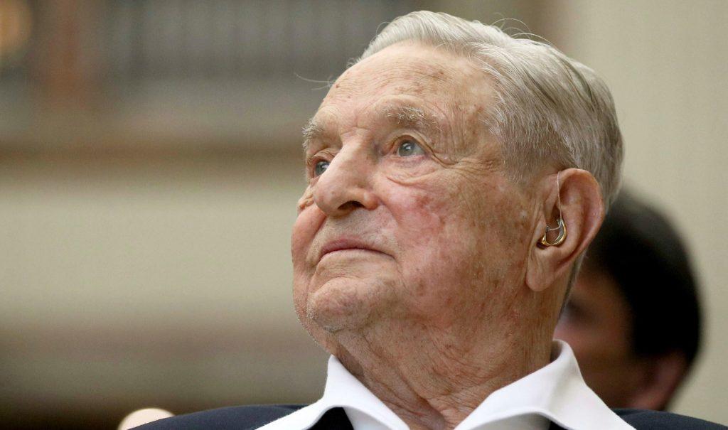 A closeup of George Soros' face.