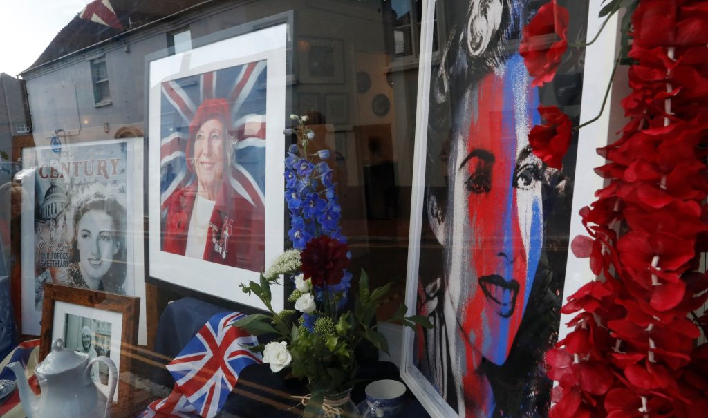 Posters and art of Vera Lynn in shop windows in UK
