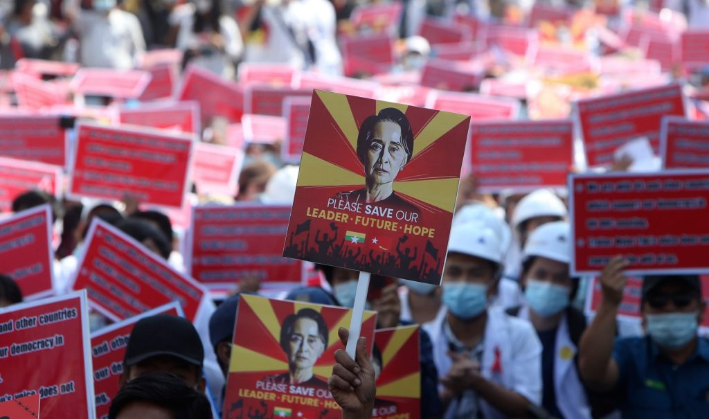 A protester holds up a placard with an image of deposed Myanmar leader Aung San Suu Kyi during an anti-coup rally in Mandalay, Myanmar, on Feb. 15, 2021. (AP Photo)