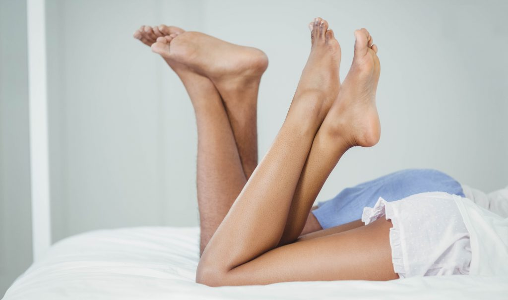 Bare legs and feet of a man and a woman [we guess?]