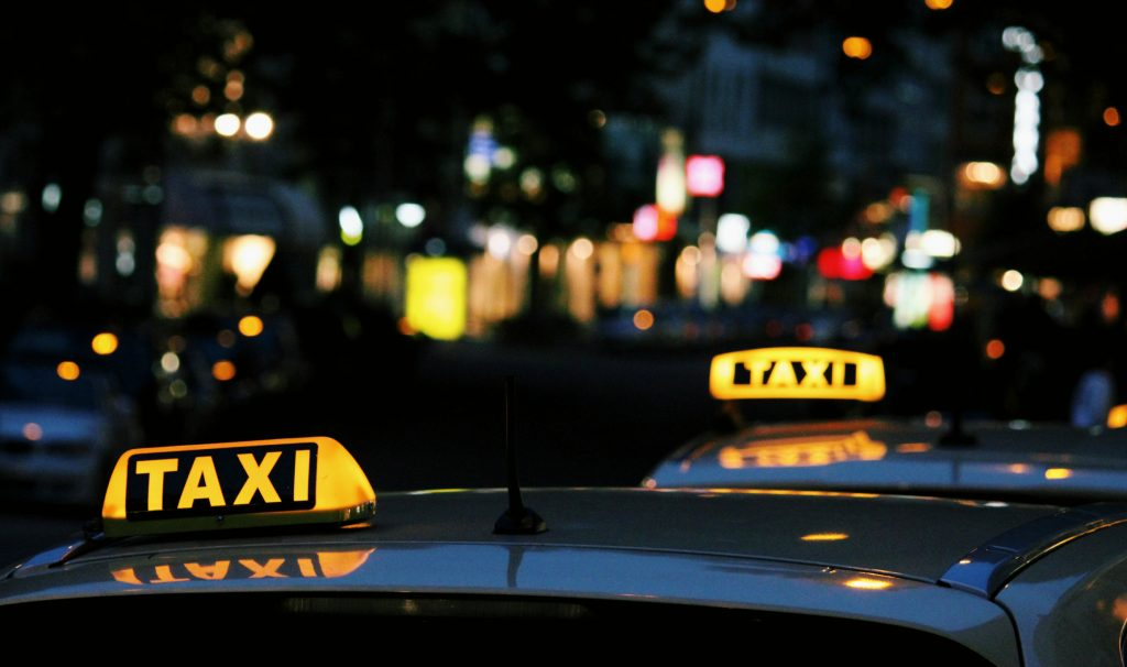 Lit-up taxi signs at night
