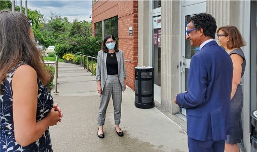 Four people standing outside the McMaster Innovation Park, home of the Canadian Longitudinal Study on Aging.