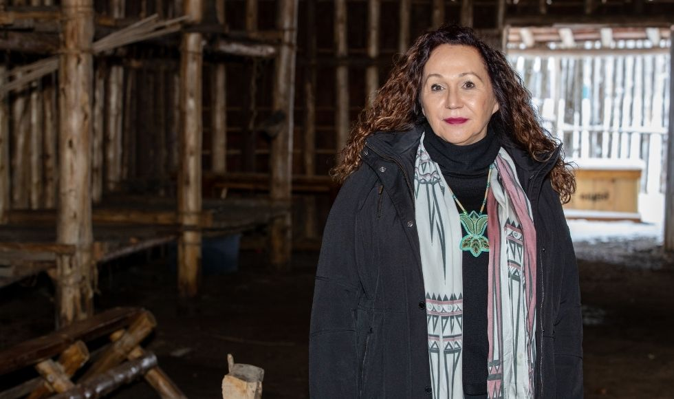 Dawn Martin-Hill standing in a wooden building